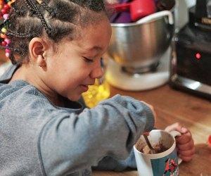 Little girl mixes mug cake