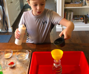 A funnel helps with pouring the ingredients into the bottle.