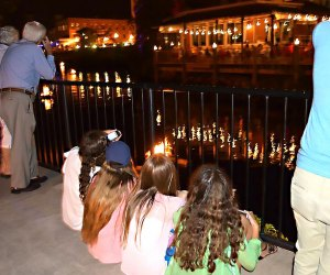 Kids settle in after fair activities to watch the River Glow. Photo courtesy of River Glow Pawcatuck