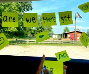 Post- its in a car window spelling are we there yet?