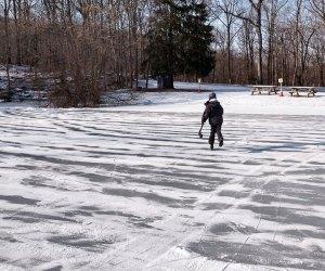 Hockey player skates on the free Sal J. Prezioso Mountain Lakes Park pond