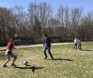 kids playing soccer in the grass