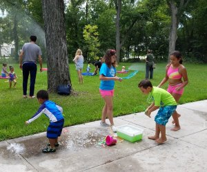 Kids can indulge in a day of water play running through sprinklers during Sprinkler Day. Photo courtesy of Nature Discovery Center.