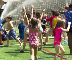Sprinkler Day at Asphalt Green is splashing, soaking fun for kids of all ages. Photo courtesy of NYC Parks