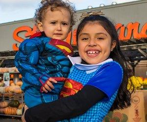 Kids pose in Halloween costumes outside Stew Leonard's