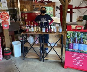 Woman sells Thompson's Hard Ciders at a market