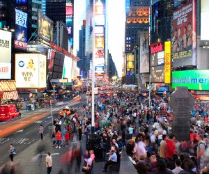 Night time view of Times Square one of our favorite tourist attractions in NYC