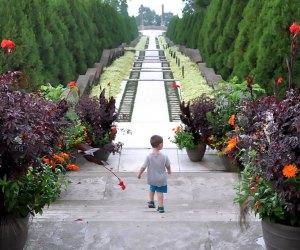 Boy walks through Untermyer Gardens where admission is free