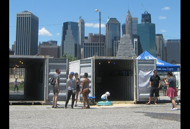 "There's a small inflatable pool outside the ""East River Ferry"" container"