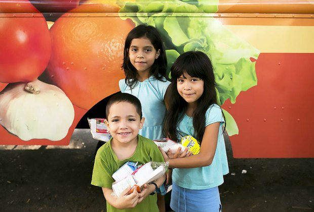 Free breakfast and lunch is available in parks, schools, and sometimes by food truck for kids across the country. Photo courtesy of Share Our Strength