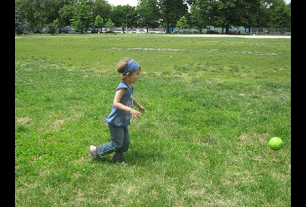 Playing on the vast grassy fields