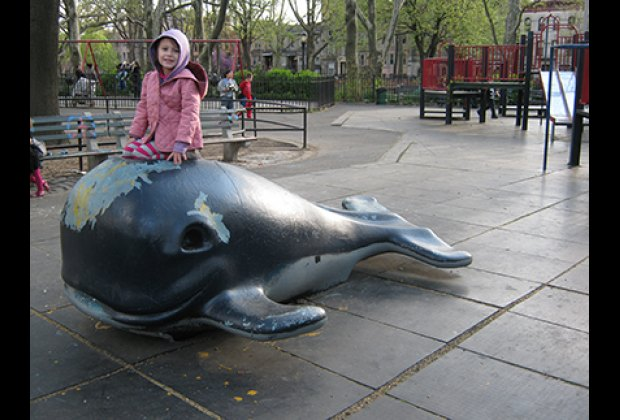 Sitting on the blue whale at Monsignor McGolrick Park Playground