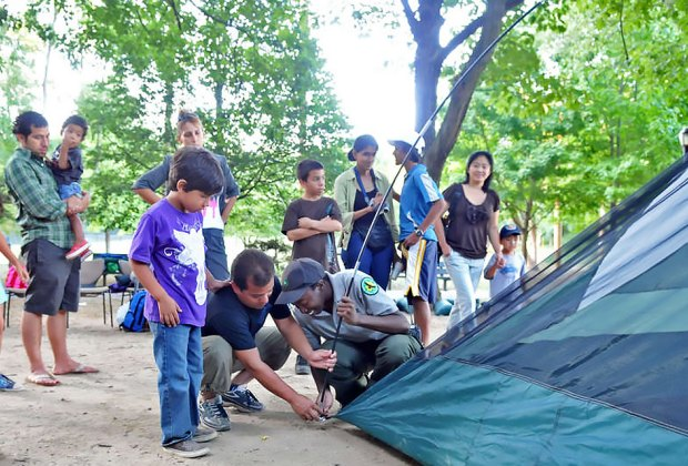 Urban Park Rangers bring tents (and set them up, too!) for family camping nights in NYC parks.