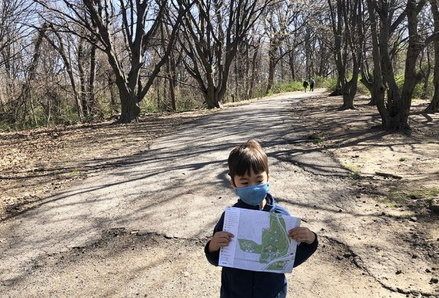 Boy on a park trial with map