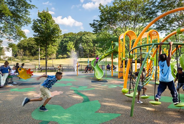 Mattapan's Hunt Almont Playground has tricky ladders, balancing toys, and other colorful equipment to swing (and splash) on. Photo by Ed Wonsek
