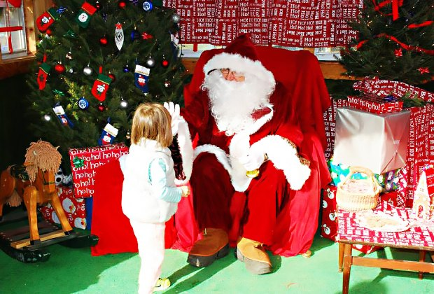 Give Santa a high five at Alstede Farms. Photo courtesy of the farm