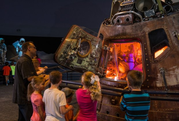 Stand close to historic flown spacecraft including the Apollo 17 command module, which was the last crewed mission to the moon. Photo courtesy of Space Center Houston.
