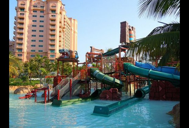 A water playground with smaller slides for the little kids (photo credit: insidethemagic)