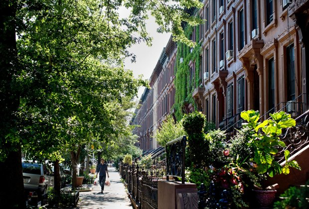 Stroll the streets of this picturesque neighborhood lined with beautiful brownstones. Photo courtesy of Gates Condos