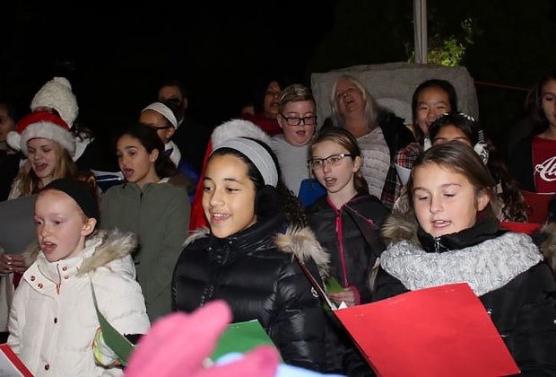 Join in Christmas caroling at the Bellmore Holiday Extravaganza. Photo courtesy of the Chamber of Commerce of the Bellmores