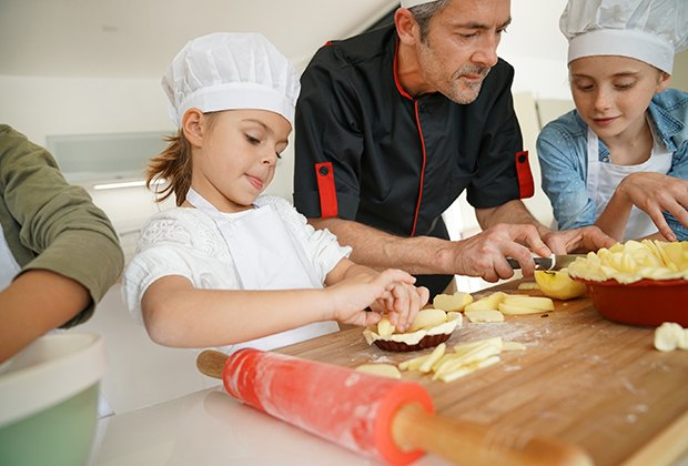 Cooking classes help kids master hand-eye coordination and practice social skills. Photo via Bigstock