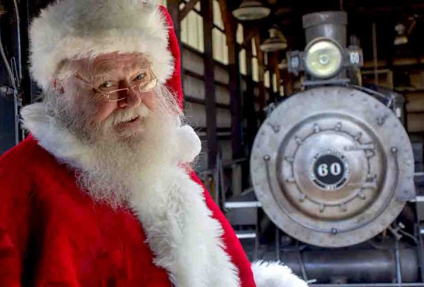 Santa poses with the North Pole Express train