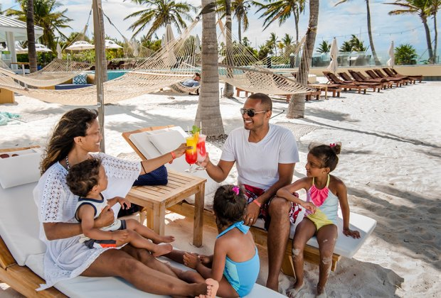 Relax by the beach at the family-friendly Blue Haven Resort in Turks and Caicos.