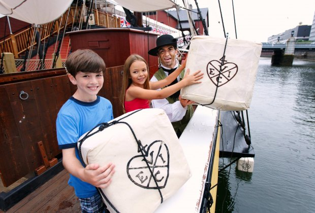 Throw tea boxes overboard at the Boston Tea Party Ships & Museum. Photo by Michael Blanchard Photography