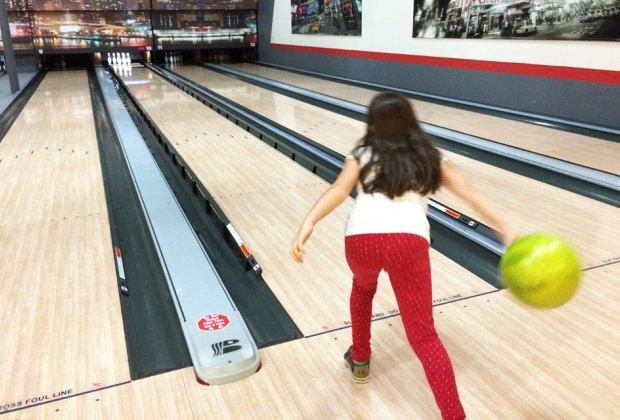 girl bowling at Spins Bowl