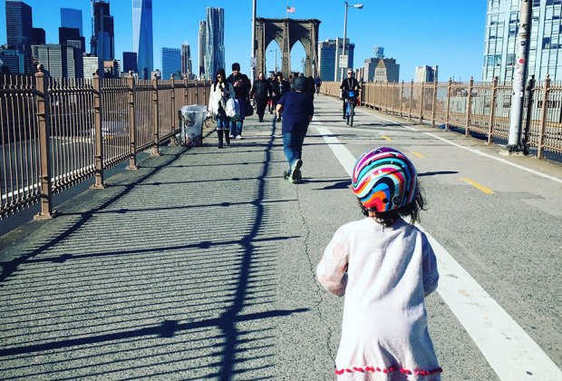 Girl scoots across the Brooklyn Bridge