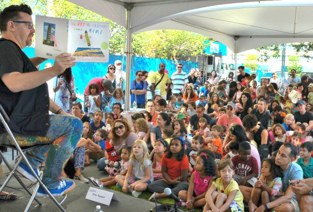Listen to a story in the Picture Book tent at the Brooklyn Book Festival Children's Day. Photo by Lisa Hannus courtesy of the event