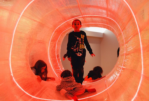 Part exhibit, part playground, TapeScape features climbing tunnels with spirals of LED lights.