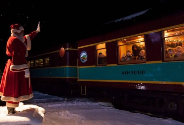 Santa greets train guests arriving at the North Pole on the Train to Christmas Town. Photo courtesy of Cape Cod Central Railroad