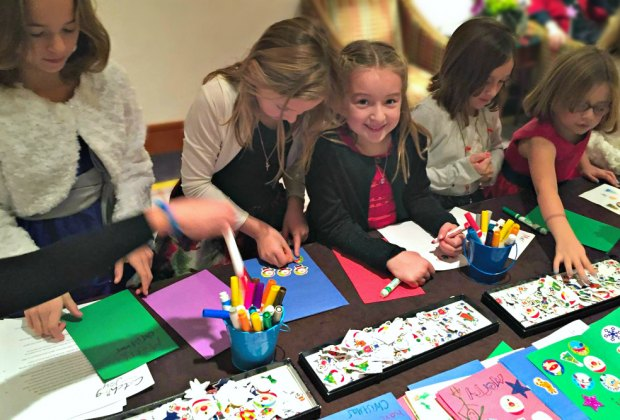 Kids pay holiday cheer forward with Catching Joy. Photo courtesy of Catching Joy's Facebook page