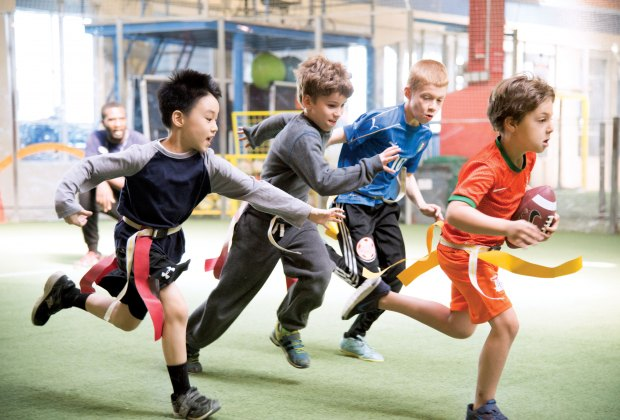 In addition to the wide variety of sports classes including baseball, basketball, soccer, and Parkour, the Field House at Chelsea Piers offers a flag football program for children ages 7 – 10 that consists of skill development and game play. Photo by Scott McDermott