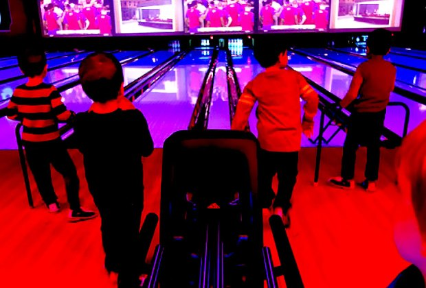 Kids enjoy a bowling birthday party at Bowlmor Chelsea Piers. Photo courtesy of Bowlmor