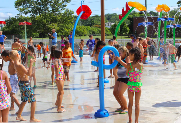 Chesley Park's splash pad has bucket dumps, ground sprays, and even gentle jets to aim at your friends. Photo courtesy of  TLB Architecture