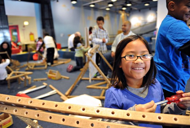 Build and design your own structure using real tools in the Chicago Children's Museum's Skyline exhibit. Photo courtesy of Chicago Children's Museum