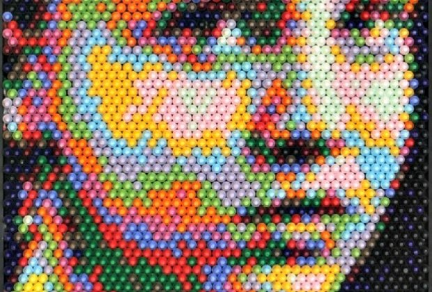 A portrait made from crayons in Pixelated: Sum of its Pieces; photo courtesy <br/>of Christian Faur