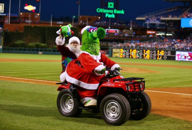 Santa and the Phanatic ride off into the sunset after a successful Christmas in July game. Photo courtesy of Miles Kennedy