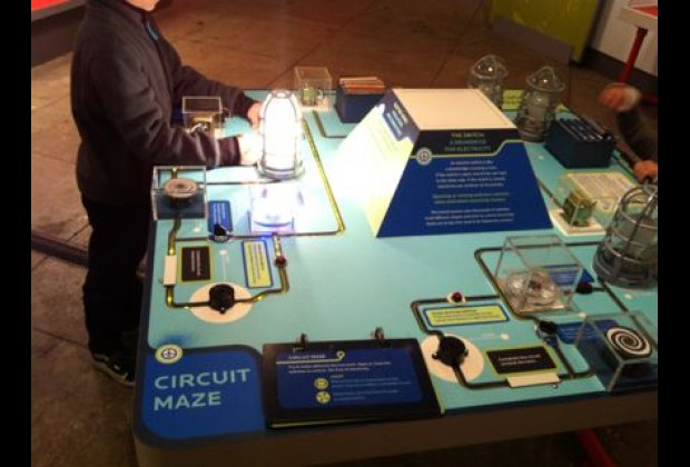 Working an interactive circuit display in the museum's ElectriCity: Powering<br /> New York's Rails exhibit