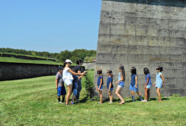 CMA Teaching Artists lead students as they explore Governors Island while scouting for a photo shoot location.