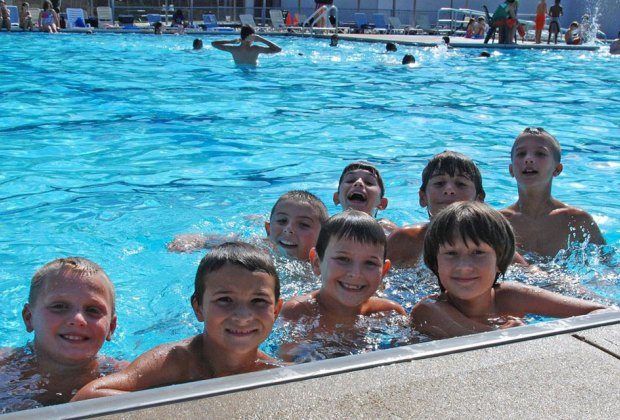 Smiling kids in the pool at Dix Hills Park