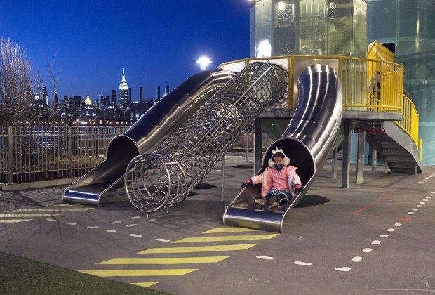 Girl on slide at domino park