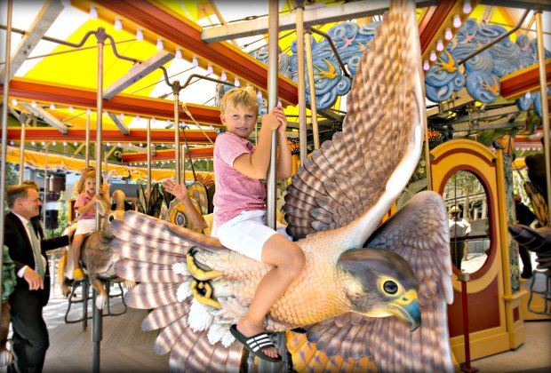 Summer has a way of flying by - grab hold at the Greenway Carousel. Photo by Ben Gebo courtesy of Massachusetts Office of Travel & Tourism