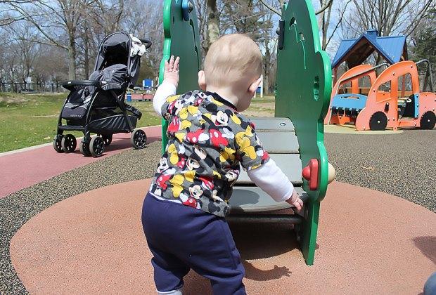 boy at playground at Eisenhower Park