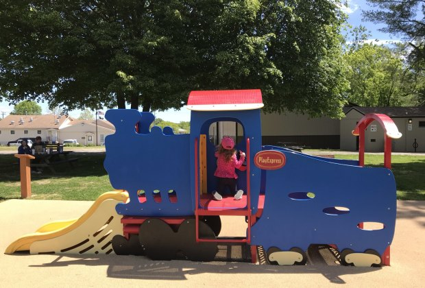 South Jersey Playgrounds girl on toy train structure