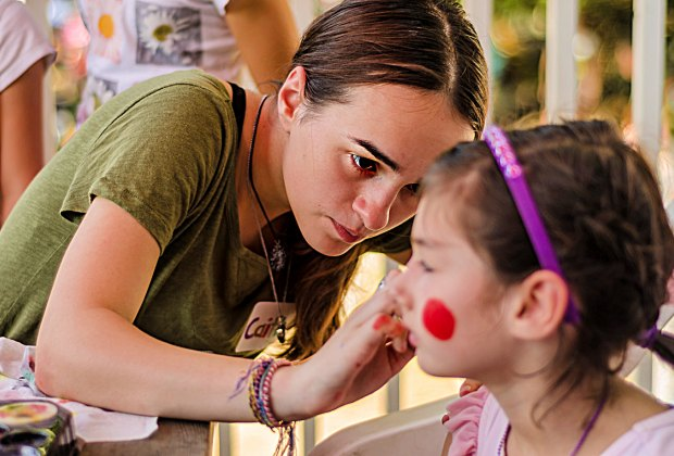 Facepainting is a hit at the Fall Festival at Newton Community Farm. Photo by Bruce Wilson