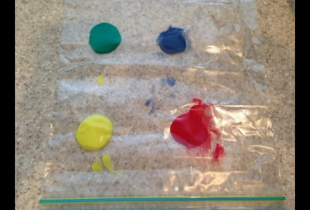 Squirt the paints into separate quadrants of the bag