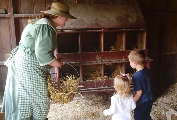 Kids can help feed the chickens at Fosterfields Living Historical Farm.
